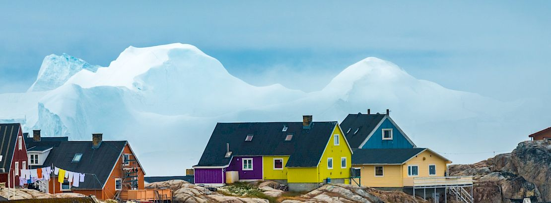 The city of Iulissat with stranded icebergs in the background, Greenland